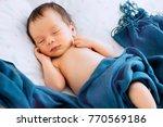 close up portrait of a newborn... | Shutterstock . vector #770569186