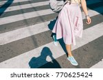 young woman in a pink skirt and ... | Shutterstock . vector #770625424