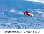 skiing in the snowy mountains ... | Shutterstock . vector #770645110