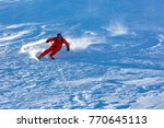 skiing in the snowy mountains ... | Shutterstock . vector #770645113