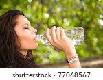 beautiful young brunette in... | Shutterstock . vector #77068567