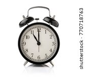 black alarm clock isolated on... | Shutterstock . vector #770718763
