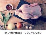 a whole raw chicken carcass... | Shutterstock . vector #770747260