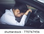 stressed of asian woman driver... | Shutterstock . vector #770767456