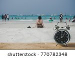 old retro clock on sand beach ... | Shutterstock . vector #770782348
