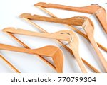 wooden hangers for clothes on a ... | Shutterstock . vector #770799304