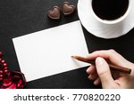 woman's hand writing on the... | Shutterstock . vector #770820220