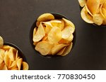 potato chips in black bowls on... | Shutterstock . vector #770830450
