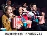 scared friends with popcorn and ... | Shutterstock . vector #770833258