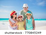 happy beautiful family on white ... | Shutterstock . vector #770845249