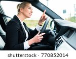 woman driving car being angry... | Shutterstock . vector #770852014