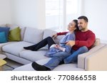young couple on the sofa... | Shutterstock . vector #770866558