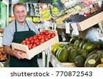 adult male seller is... | Shutterstock . vector #770872543