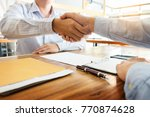 two confident business man... | Shutterstock . vector #770874628