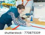 worker measuring a foam | Shutterstock . vector #770875339