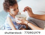 african woman giving her baby... | Shutterstock . vector #770901979