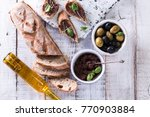 green and black olives in tin... | Shutterstock . vector #770903884