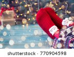 feet in christmas socks. girl... | Shutterstock . vector #770904598