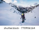 a girl walks with snowshoes in...   Shutterstock . vector #770906164