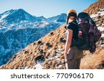 a girl stands watching the...   Shutterstock . vector #770906170