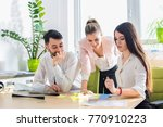 young business team reading... | Shutterstock . vector #770910223