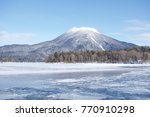 Small photo of Frozen Lake Akan, Hokkaido. Lake Akan was born from the eruption of a volcano. It is surrounded by Mount Meakan and Mount Oakan