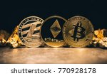 Stock photo golden cryptocurrencys bitcoin ethereum litecoin and mound of gold business concept image 770928178