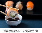 chopstick with sushi roll and... | Shutterstock . vector #770939470