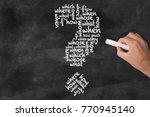 hand holding piece of chalk... | Shutterstock . vector #770945140