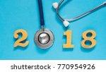 stethoscope w  2018 gold wooden ... | Shutterstock . vector #770954926