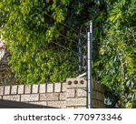 Small photo of Electric fence atop a gate to ensure security at housing complex on George South Africa in an effort to thwart criminals