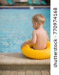 back view on cute toddler boy... | Shutterstock . vector #770974168