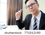 asian businessman is writing... | Shutterstock . vector #771012190