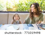 happy family sitting in... | Shutterstock . vector #771019498