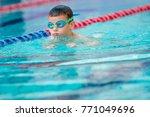 boy swimming freestyle | Shutterstock . vector #771049696
