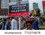 Small photo of Malaysian muslim holds a playcard during protest against the U.S. President Donald Trump's announcement to recognize Jerusalem as the capital of Israel in Kuala Lumpur on December 8, 2017.
