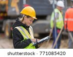 female builder in hardhat with... | Shutterstock . vector #771085420