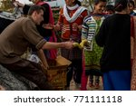 Small photo of Kangra, India - November 24, 2017: Free distribution of eatables to school kids during a camp organised.