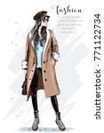 Fashion model posing. Stylish beautiful woman in coat and cap. Hand drawn fashion woman. Sketch. Vector illustration. | Shutterstock vector #771122734