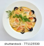 Small photo of dish with musseles. mussels cooked with milk souse decorayed with green leaves