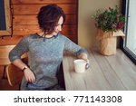 cute woman drinking coffee in... | Shutterstock . vector #771143308