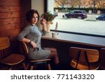 cute woman drinking coffee in... | Shutterstock . vector #771143320