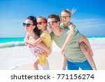 happy beautiful family on a... | Shutterstock . vector #771156274