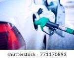 refueling gun in the tank at... | Shutterstock . vector #771170893
