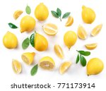 ripe lemons and lemon leaves on ... | Shutterstock . vector #771173914