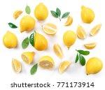 Ripe Lemons And Lemon Leaves O...