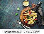 whole grain pasta with tomato... | Shutterstock . vector #771196144