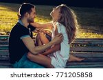 a man and a woman are sitting...   Shutterstock . vector #771205858
