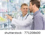 cheerful young male pharmacist... | Shutterstock . vector #771208600