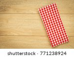kitchen cloth on wood table... | Shutterstock . vector #771238924